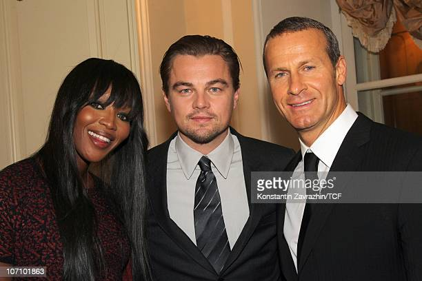 Model Naomi Campbell actor Leonardo DiCaprio and her boyfrend CEO of Captal Group Vladislav Doronin pose as they attend the International Tiger...