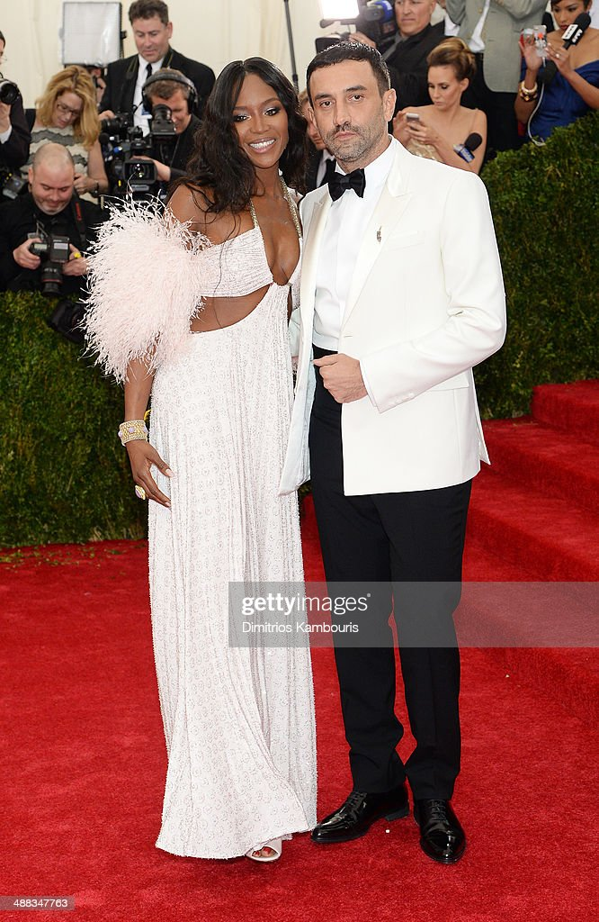 Model Naomi Campbell (L) and designer Riccardo Tisci attend the 'Charles James: Beyond Fashion' Costume Institute Gala at the Metropolitan Museum of Art on May 5, 2014 in New York City.