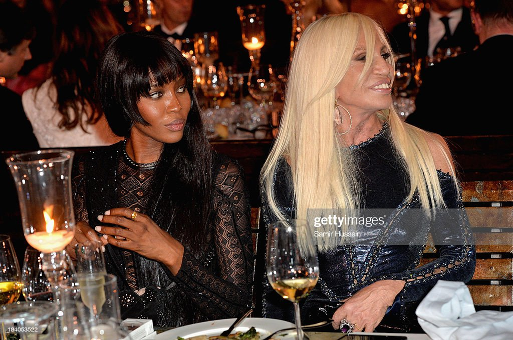 Model Naomi Campbell and Donatella Versace attend the gala dinner at the Armani Pavilion during Vogue Fashion Dubai Experience on October 10, 2013 in Dubai, United Arab Emirates.