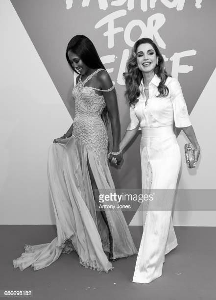 Model Naomie Campbell and Queen Rania of Jordan attend the Fashion for Relief event during the 70th annual Cannes Film Festival at Aeroport Cannes...