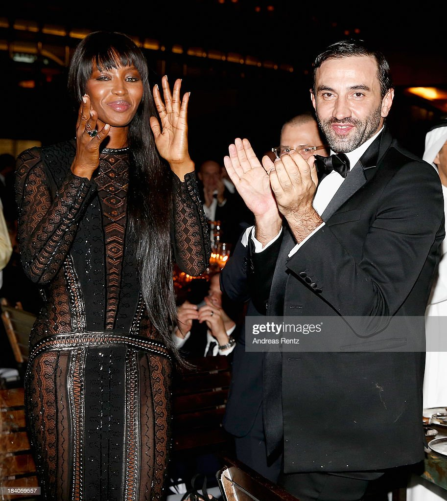 Model Naomi Campbell and Riccardo Tisci attend the gala dinner at the Armani Pavilion during Vogue Fashion Dubai Experience on October 10, 2013 in Dubai, United Arab Emirates.