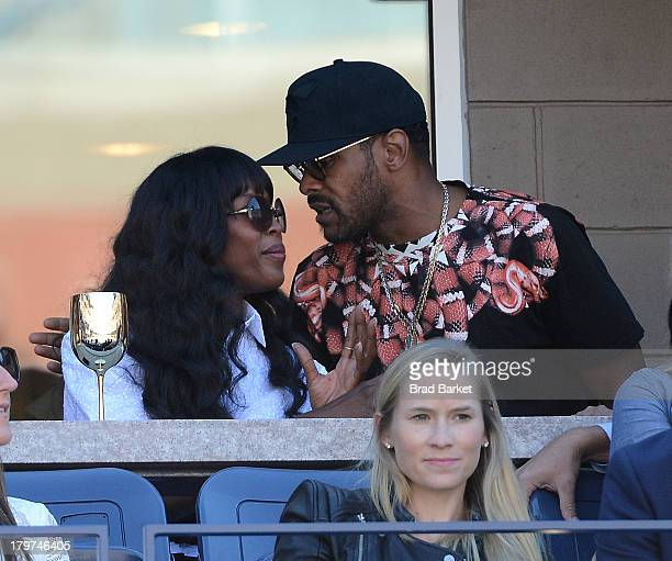 Model Naomi Campbell and Singer Gerald Maxwell Rivera also known as Maxwell attends The Moet Chandon Suite at the USTA Billie Jean King National...