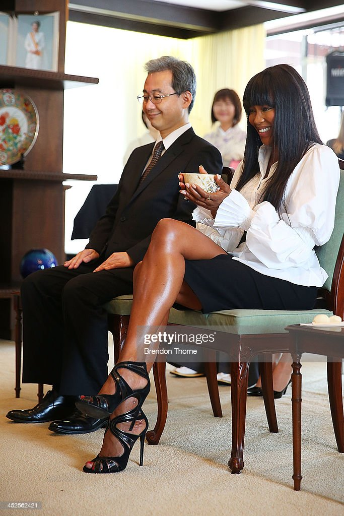 Model <a gi-track='captionPersonalityLinkClicked' href=/galleries/search?phrase=Naomi+Campbell&family=editorial&specificpeople=171722 ng-click='$event.stopPropagation()'>Naomi Campbell</a> and Toshiaki Kobayashi, acting Consult-General of Japan in Sydney drink traditional Japanese tea at a Japanese Tea ceremony held to acknowledge her donation to help with post-tsunami rebuild at the Consulate General of Japan on November 30, 2013 in Sydney, Australia.