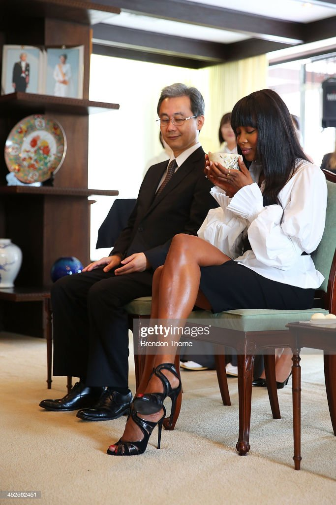 Model Naomi Campbell and Toshiaki Kobayashi, acting Consult-General of Japan in Sydney drink traditional Japanese tea at a Japanese Tea ceremony held to acknowledge her donation to help with post-tsunami rebuild at the Consulate General of Japan on November 30, 2013 in Sydney, Australia.