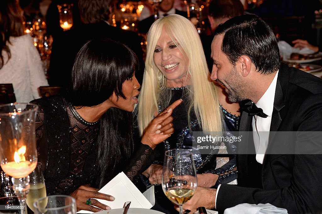Model Naomi Campbell, Donatella Versace and Riccardo Tisci attend the gala dinner at the Armani Pavilion during Vogue Fashion Dubai Experience on October 10, 2013 in Dubai, United Arab Emirates.