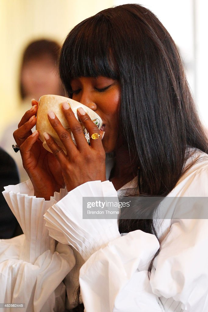Model Naomi Campbell drinks traditional Japanese tea at a Japanese Tea ceremony held to acknowledge her donation to help with post-tsunami rebuild at the Consulate General of Japan on November 30, 2013 in Sydney, Australia.