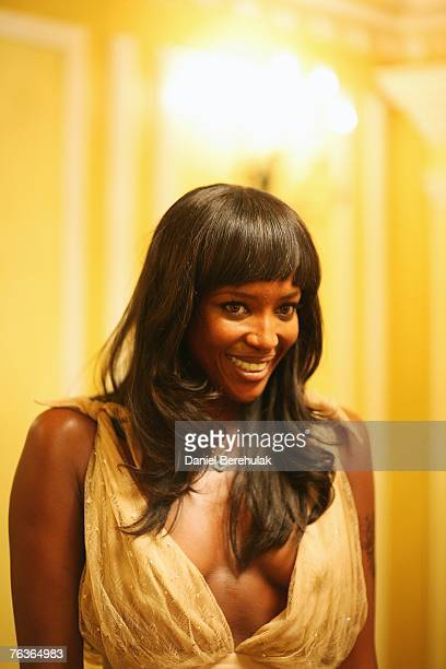 Model Naomi Campbell poses for a photograph during an honourary dinner at the Dorchester Hotel on August 28 2007 in London England Leading black...