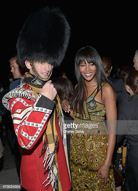 Model Naomi Campbell poses with a First Battalion Grenadier Guard during the Burberry 'London in Los Angeles' event at Griffith Observatory on April...