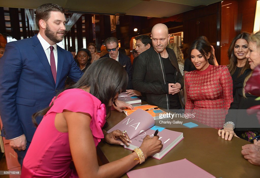 Model <a gi-track='captionPersonalityLinkClicked' href=/galleries/search?phrase=Naomi+Campbell&family=editorial&specificpeople=171722 ng-click='$event.stopPropagation()'>Naomi Campbell</a> (L) signs a copy of her book for <a gi-track='captionPersonalityLinkClicked' href=/galleries/search?phrase=Kim+Kardashian&family=editorial&specificpeople=753387 ng-click='$event.stopPropagation()'>Kim Kardashian</a> (R) at the Los Angeles launch of 'Naomi' at Taschen Beverly Hills on April 28, 2016 in Beverly Hills, California.