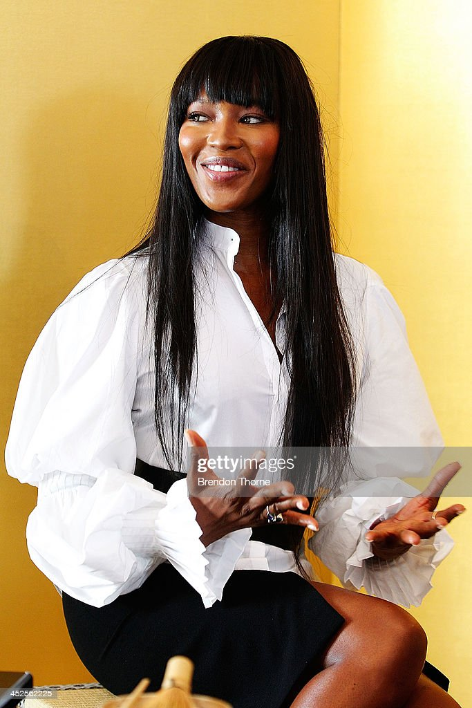 Model <a gi-track='captionPersonalityLinkClicked' href=/galleries/search?phrase=Naomi+Campbell&family=editorial&specificpeople=171722 ng-click='$event.stopPropagation()'>Naomi Campbell</a> speaks with a tea master at a Japanese Tea ceremony held to acknowledge her donation to help with post-tsunami rebuild at the Consulate General of Japan on November 30, 2013 in Sydney, Australia.