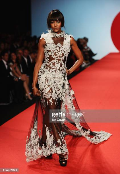 Model Naomi Campbell walks the runway at the Fashion For Relief at Forville market during the 64th Annual Cannes Film Festival on May 16 2011 in...