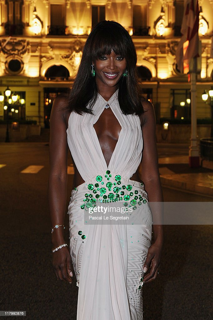Model Naomi Campbell wearing a Givenchy dress attends a dinner at Opera terraces after the religious wedding ceremony of Prince Albert II of Monaco and Princess Charlene of Monaco on July 2, 2011 in Monaco.