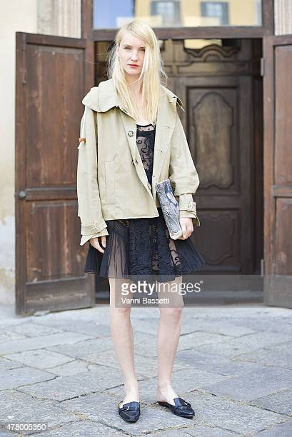 Model Nastia Shershen poses wearing a Carven jacket N21 bag and dress and Hermes shoes on June 21 2015 in Milan Italy
