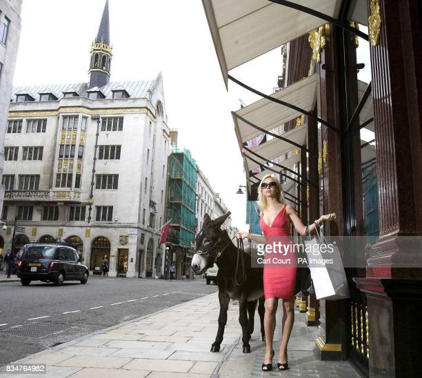 Model Natalia Zhuzlova shops on New Bond Street London with a real 'Moscow Mule' to promote a new Schweppes ad campaign