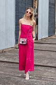 Model Natalie Cantell wears a Juliette Hogan jumpsuit Furla bag Sempre Di shoes and Karen Walker sunglasses at MercedesBenz Fashion Week Australia...