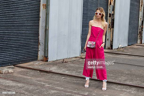 Model Natalie Cantell wears a Juliette Hogan jumpsuit Furla bag Sempre Di shoes and Karen Walker sunglasses at MercedesBenz Fashion Week Australia...
