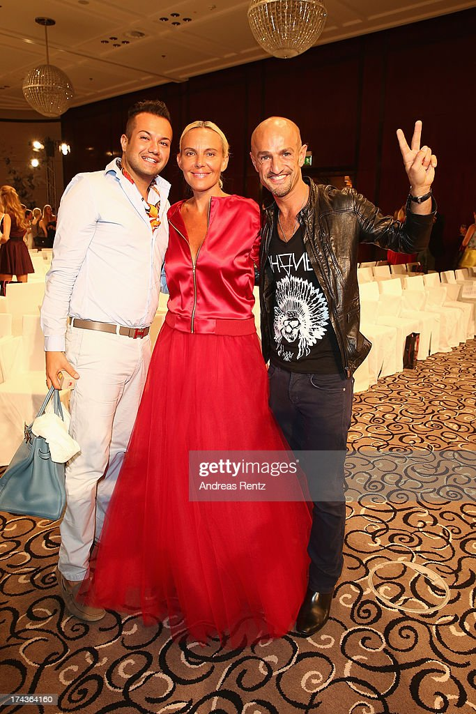 Model Natascha Ochsenknecht (C) and Peyman Amin (R) attend the Marcel Ostertag fashion show at Charles Hotel on July 24, 2013 in Munich, Germany.
