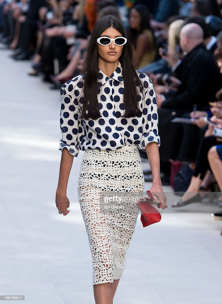 Model Neelam Johal walks the runway at the Burberry Prorsum show at London Fashion Week SS14 at Kensington Gardens on September 16, 2013 in London, England.