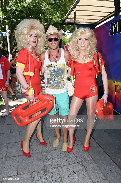 Model Nico Schwanz and guests attend the Christopher Street Day gay pride parade on July 19 2014 in Munich Germany