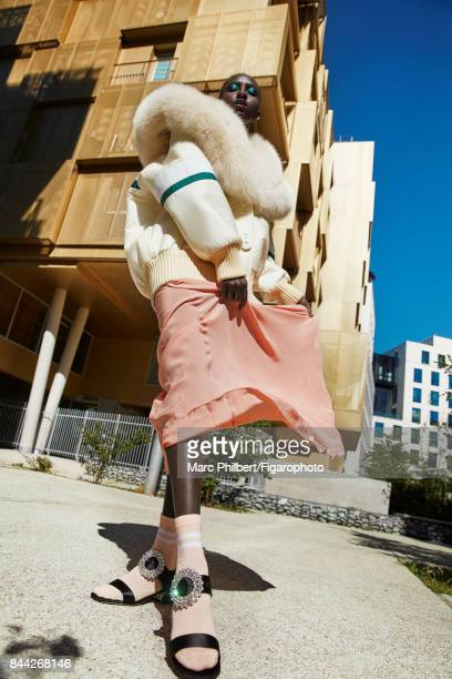 Model poses at a fashion shoot for Madame Figaro on June 19 2017 in Paris France Coat skirt and sandals Miu Miu socks PUBLISHED IMAGE CREDIT MUST...