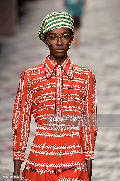 Model Nicole Atieno walks the runway at the Gucci Spring Summer 2016 fashion show during Milan Fashion Week on September 23 2015 in Milan Italy