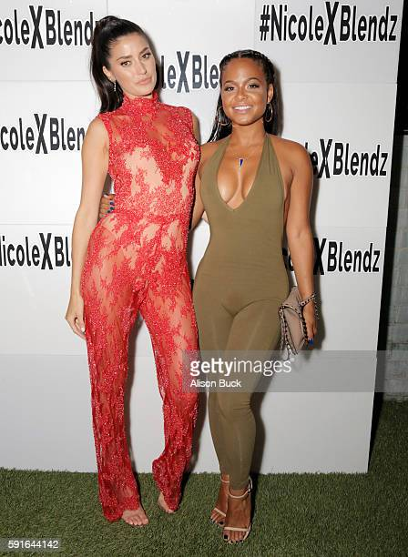 Model Nicole Williams and singer Christina Milian attend the launch of BodyBlendz Mandarin Mist at Petit Ermitage on August 17 2016 in Hollywood...