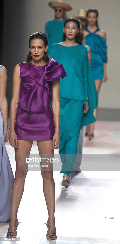 Model nieves Alvarez (purple dress) and some models showcase designs by Duyos on the runway at Duyos show during Mercedes Benz Fashion Week Madrid Spring/Summer 2014 at Ifema on September 13, 2013 in Madrid, Spain.