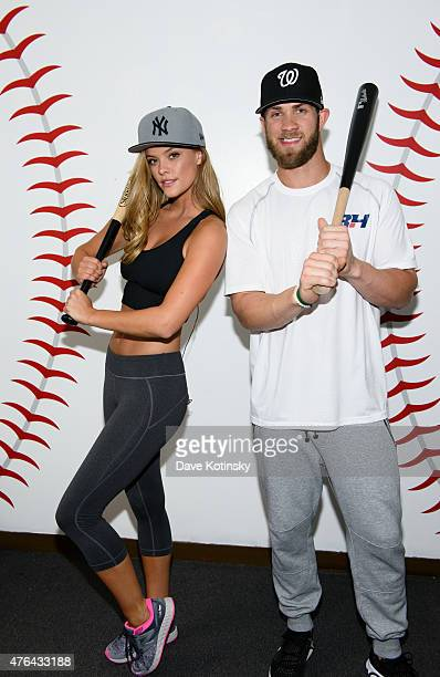 Model Nina Agdal and baseball player Bryce Harper of the Washington Nationals pose during a New Era shoot on June 8 2015 in Fairfield New Jersey