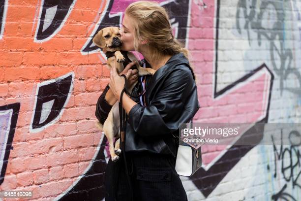 Model Nina Agdal with her dog seen in the streets of Manhattan outside Zadig Voltaire during New York Fashion Week on September 11 2017 in New York...