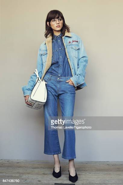 Model poses at a fashion shoot for Madame Figaro on July 17 2017 in Paris France Jacket shirt jeans shoes Sellahs Bag sunglasses PUBLISHED IMAGE...