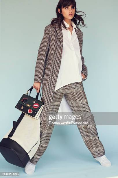 Model poses at a fashion shoot for Madame Figaro on July 17 2017 in Paris France Coat shirt pants bag duffle bag sneakers PUBLISHED IMAGE CREDIT MUST...