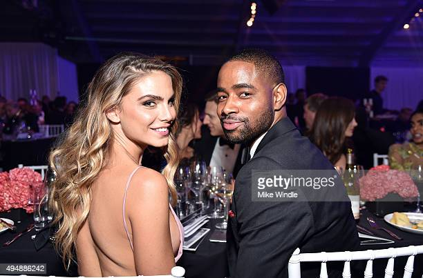Model Nina Senicar and actor Jay Ellis attend amfAR's Inspiration Gala Los Angeles at Milk Studios on October 29 2015 in Hollywood California