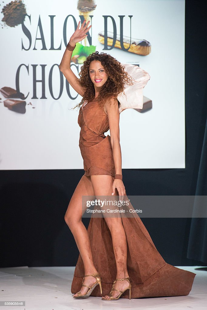 Model Noemie Lenoir walks the runway and wears 'Galactica' a chocolate dress made by designer Selimetu Jane and chocolate maker Vincent Guerlais during the Fashion Chocolate Show at Salon du Chocolat at Portes de Versailles, in Paris.