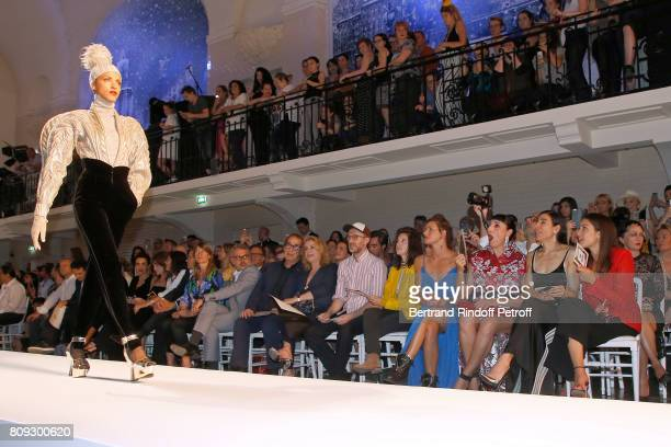 Model Noemie Lenoir walks the runway in front of Farida Khelfa Seydoux Carla BruniSarkozy Emmanuelle Alt Owners of Gaultier Manuel Puig and his...