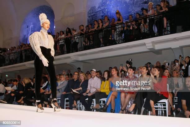 Model Noemie Lenoir walks the runway in front of Vincent Dedienne Amanda Lear Marc Puig Gilles Dufour Catherine Deneuve Loic Prigent Aloise Sauvage...