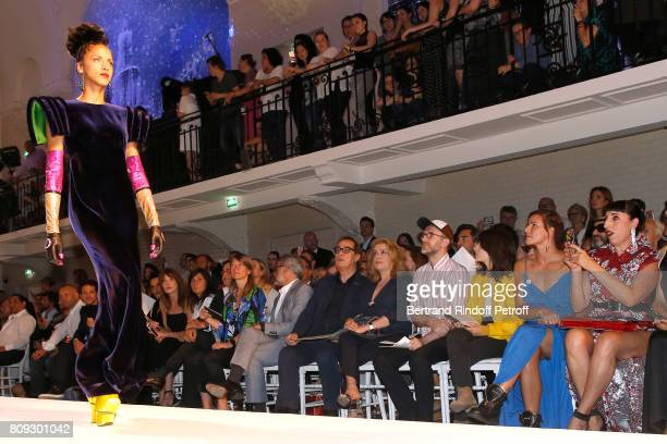 Model Noemie Lenoir walks the runway in front of Vincent Dedienne Carla BruniSarkozy Emmanuelle Alt Owners of Gaultier Manuel Puig and his brother...
