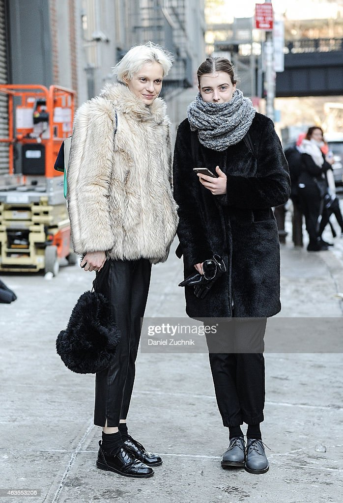 Model Nora Vai(L) is seen outside the DKNY show on February 15, 2015 in New York City.