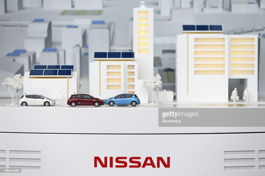 A model of a city plan with Nissan Motor Co. Leaf electric vehicles (EV) is displayed at the company's showroom in Yokohama, Kanagawa Prefecture, Japan, on Friday, Feb. 8, 2013. Nissan, Japan's second-biggest carmaker, reported third-quarter profit that fell short of analysts' estimates, after sales tumbled in China and new models trailed competitors in the U.S. Photographer: Kiyoshi Ota/Bloomberg via Getty Images