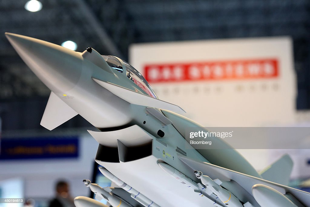 A model of a Eurofighter Typhoon aircraft, manufactured by BAE Systems Plc., is seen on display at the company stand during the 13th Dubai Airshow at Dubai World Central (DWC) in Dubai, United Arab Emirates, on Sunday, Nov. 17, 2013. The 13th edition of the biennial 2013 Dubai Airshow, the Middle East's leading aerospace event organized by F&E Aerospace. Photographer: Duncan Chard/Bloomberg via Getty Images