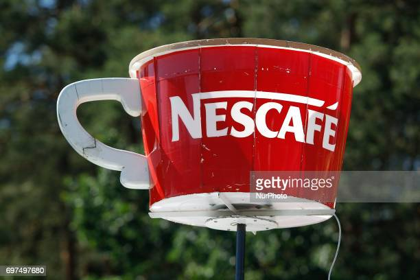 A model of a giant coffee cup with the Nescafe brand is seen on top of a food truck in Myslecinek park during the summer openere festival on 18 June...