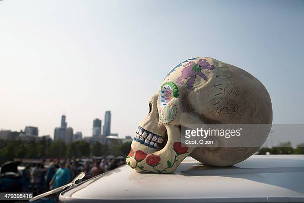 A model of a human skull sits on top of a van during a Grateful Dead concert at Soldier Field on July 3 2015 in Chicago Illinois The show is one of...