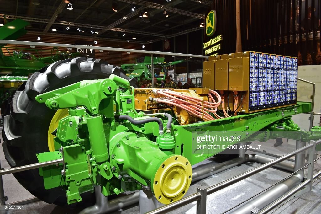 A model of a John Deere Sesam electric tractor is displayed during the SIMA, Paris International agribusiness show at the Parc des Expositions Paris Nord in Villepinte on February 26, 2017. / AFP / CHRISTOPHE