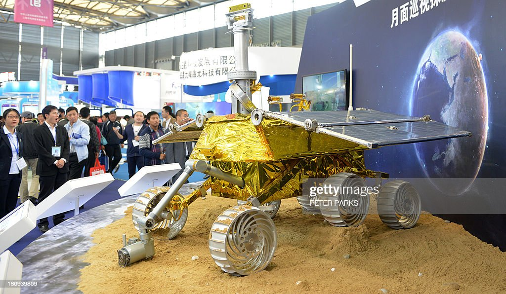 A model of a lunar rover that will explore the moon's surface in an upcoming space mission is seen on display at the China International Industry Fair 2013 in Shanghai on November 5, 2013. The rover's designer, Shanghai Aerospace Systems Engineering Research Institute, said the real thing would be lifted aloft by a Long March 3B rocket scheduled to be launched in early December. AFP PHOTO/Peter PARKS