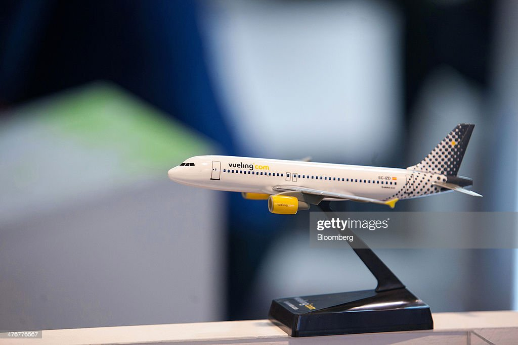 A model of a Vueling Airlines SA aircraft, the low-cost carrier operated by International Airlines Group SA (IAG SA), sits on display at the ITB Berlin tourism fair at Messe Berlin exhibition center in Berlin, Germany, on Wednesday, March 5, 2014. Archaic rules, taxes as high as those imposed on alcohol and an infrastructure deficit, especially in Asia, are curbing the aviation industry's growth, the International Air Transport Association said. Photographer: Krisztian Bocsi/Bloomberg via Getty Images