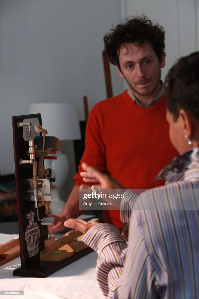 A model of an action is used in demonstration as piano tuner and technician Antoine Dubay gives a workshop about the history of the piano and its mechanical parts near a Steinway grand piano in the Salon during 'It's All About Piano!' festival at The Institut Francais on March 24, 2013 in London, England. The festival is a collaboration from French Music Office to celebrate the piano with recitals from classical to jazz, film screenings, children's activities, workshops and cinema screenings exploring the musical instrument.