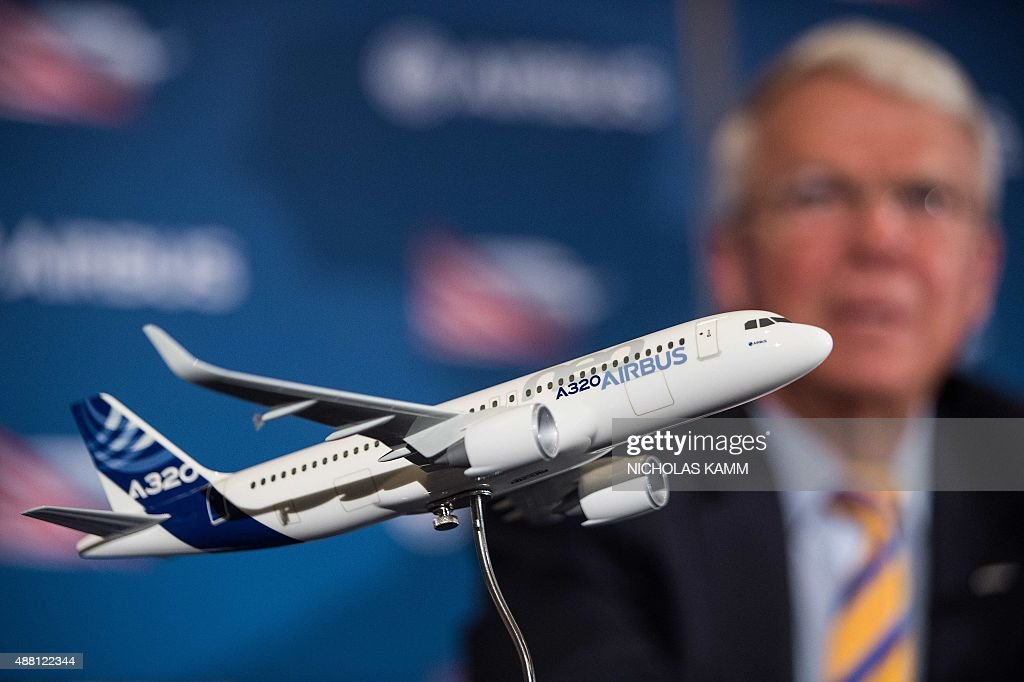 A model of an Airbus A320 jetliner is seen as Allan McArtor Airbus Group Inc Chairman and CEO speaks at a press conference in Mobile Alabama on...