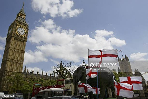 A model of an elephant decorated with Saint George cross flags is trailed passed the Houses of Parliament on June 21 2006 in London England
