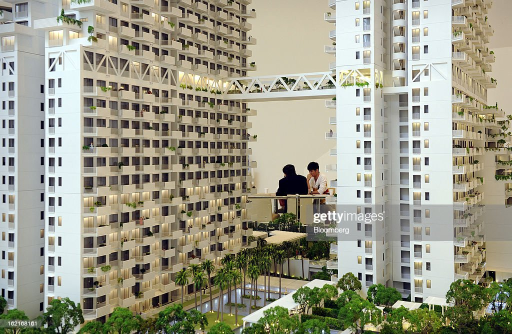 A model of CapitaLand Ltd.'s Sky Habitat condominium is displayed at the Sky Habitat showroom in Singapore, on Sunday, Feb. 17, 2013. CapitaLand, Southeast Asia's biggest developer, is scheduled to release fourth quarter earnings on Feb. 21. Photographer: Munshi Ahmed/Bloomberg via Getty Images