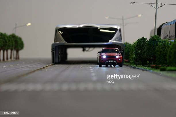 A model of Chinese straddling bus TEB runs on the sand table during the InnoTrans 2016 on September 21 2016 in Berlin Germany The InnoTrans 2016 the...