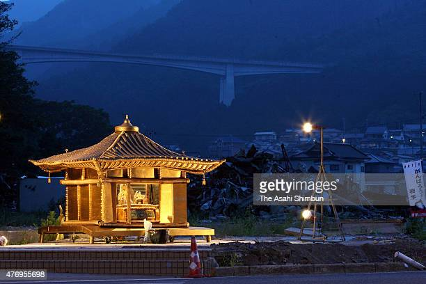 A model of Chusonji Temple's Konjikido Hall is installed at the tsunami devastated Ofunato City on August 15 2011 in Ofunato Miyagi Japan